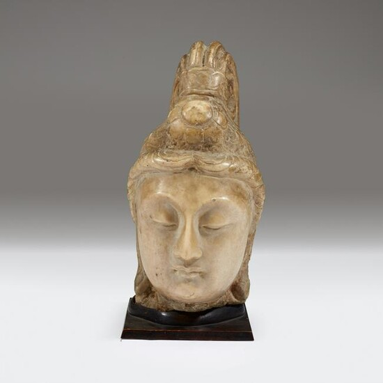 A Chinese carved stone head of bodhisattva, Possibly