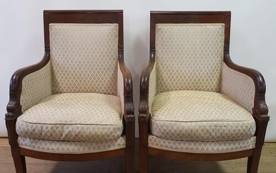 A French Empire style mahogany three piece suite, comprising...