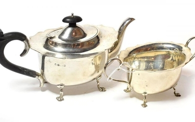 A George V silver teapot and sugar-bowl, maker's mark probably...