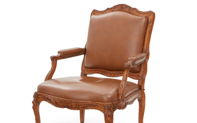 A Louis XV Style Leather Upholstered Walnut Fauteuil