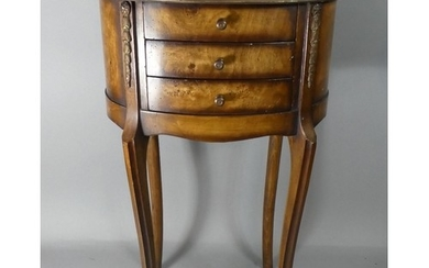 A Reproduction Oval Three Drawer Chest on Extended Cabriole ...