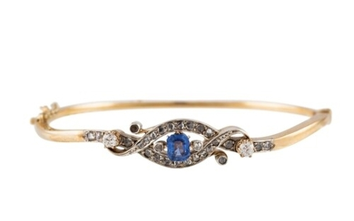 A SAPPHIRE AND DIAMOND BANGLE, the cushion cut sapphire to ...