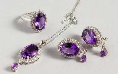 A SILVER AND AMETHYST SET, EARRINGS, PENDANT AND RING.