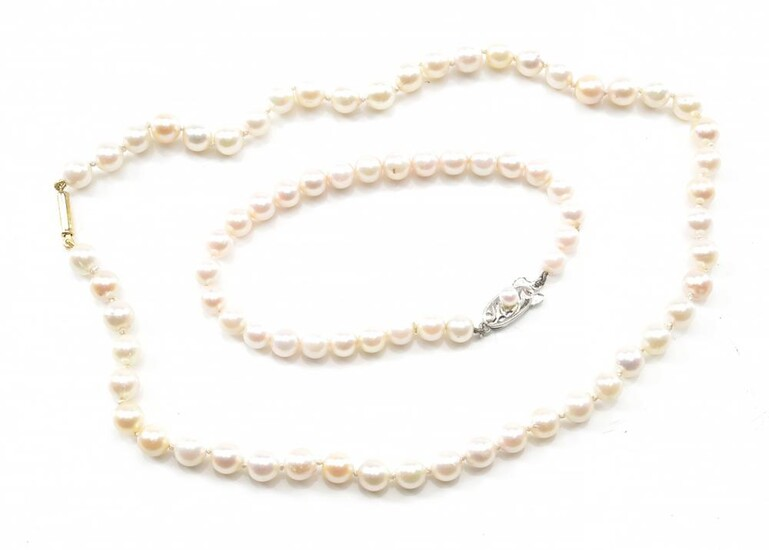 A STRAND OF AKOYA PEARLS, TOGETHER WITH AN AKOYA PEARL BRACELET