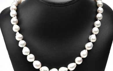 A STRAND OF THIRTY NINE BAROQUE SOUTH SEA PEARLS TO A STERLING SILVER CLASP