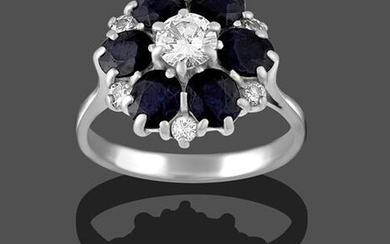 A Sapphire and Diamond Cluster Ring, the round brilliant cut...