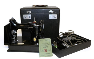A Singer Portable Sewing Machine No 221K1, together with accessories...