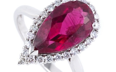 A TOURMALINE AND DIAMOND RING; set in platinum with a pear cut rubellite (pink tourmaline) of approx. 4.10ct surrounded by 24 round...