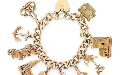 A VINTAGE CHARM BRACELET in yellow gold, comprising a