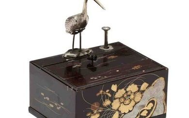 A Vintage Japanese Mechanical Cigarette Dispenser with