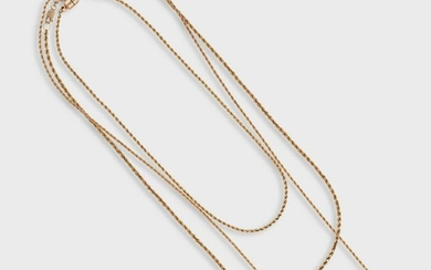 A collection of three fourteen karat gold chain