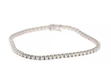 A diamond bracelet set with numerous brilliant-cut diamonds weighing a total of app. 3.88 ct., mounted in 18k white gold. G-H/SI-P1. L. app. 19 cm.