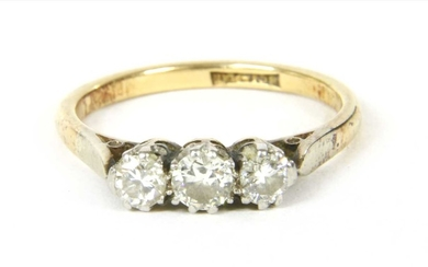 A gold three stone diamond ring