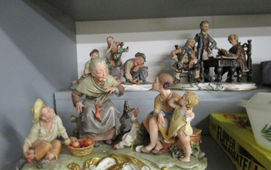 A group of three large Capodimonte figures to include one si...