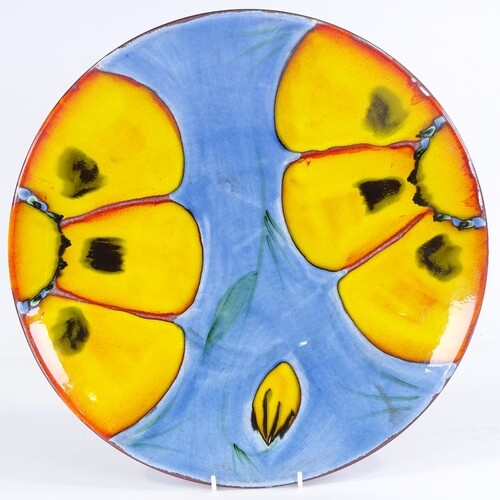 A large Poole Pottery charger, 39.5cm diameter