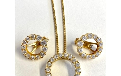 A matching 18ct diamond pendant and earrings, the open circu...