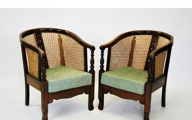 A pair of early 20th century stained beech wood rattan tub c...