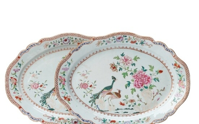 A pair of famille rose 'double peacock' serving dishes, Qing dynasty, Qianlong (1736-95).