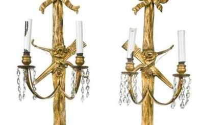 A pair of gilt gesso wall lights