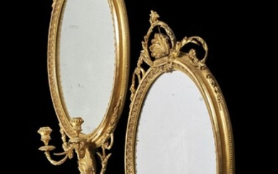 A pair of giltwood girandole wall mirrors, in George III style, late 19th century