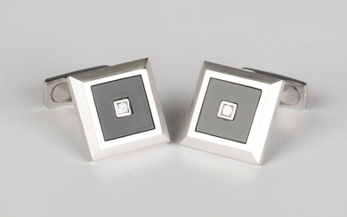 A pair of white gold, black onyx and diamond dress cufflinks, each square front mounted with a centr