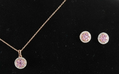 A pink sapphire and diamond pendant and matching earstuds.