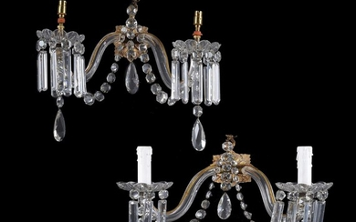A set of four Victorian cut and moulded glass and gilt metal mounted twin light lustre wall applique