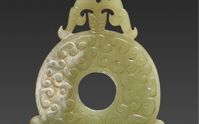 A small Chinese jade Bi-disc in the style of the Warring States period, circa 1900