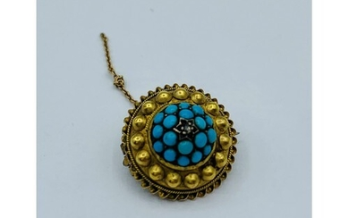 A yellow metal circular brooch with Centre cluster of turquo...