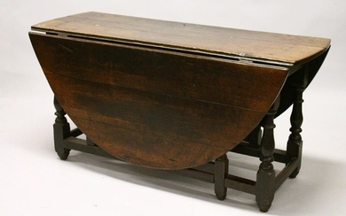 AN 18TH CENTURY OAK OVAL GATE-LEG DINING TABLE, with