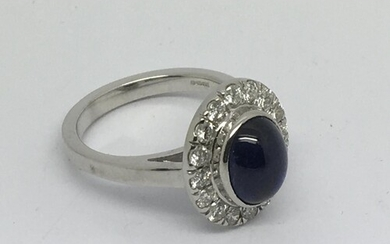 An 18ct white gold diamond and cabuchon sapphire cluster rin...