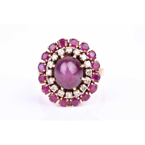 An 18ct yellow gold, diamond, and ruby oval cluster ring cen...