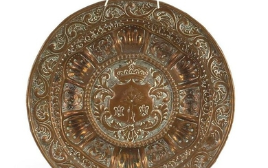 Antique copper plate embossed with a heraldic crest,