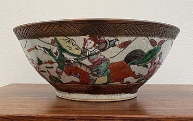 NOT SOLD. A Chinese porcelain bowl decorated with cracle glaze and battle scenes in colours....