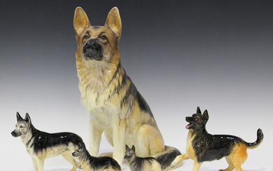 Five Beswick models of Alsatians, Nos. 969, 1762A, 1762B, 2410 and 3073, together with a group of ot