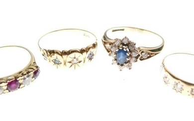 Four assorted rings comprising 18ct gold and three stone...