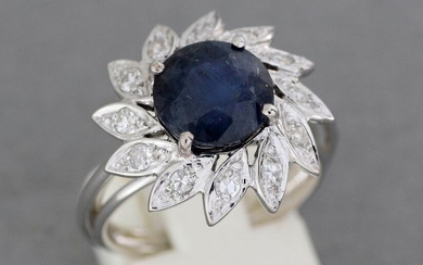 """Gold """"flower"""" ring set with a sapphire of about 4.1 carats surrounded by brilliants - Gross weight: 5.4 g - Finger size: 52"""