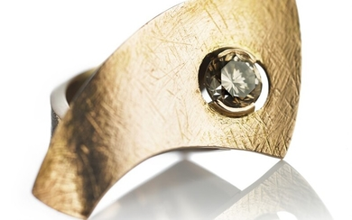"""Jytte Kløve: A diamond ring """"Pi"""" set with a brilliant-cut champagne coloured diamond weighing app. 1.48 ct. and white diamonds, mounted in 14k gold. G/VVS."""