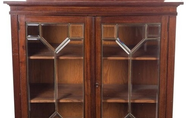 Low English display cabinet in mahogany wood with bronze louvered doors. 19th century. With key. 106 x 36 x 97 cm
