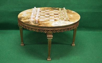 Onyx topped chess table the circular top supported on a pier...
