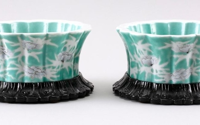 PAIR OF CHINESE GREEN AND WHITE PORCELAIN FLORIFORM DISHES Detailed flowers, including spider chrysanthemums, on a flower and vine-o...