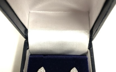 Pair Of 18ct Mounted Diamond cluster earrings