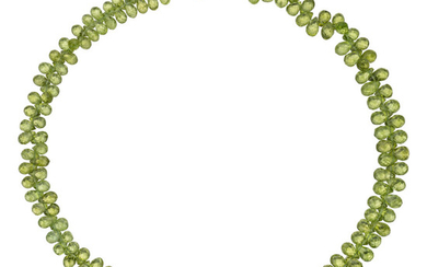 Peridot, Diamond, Gold Necklace The necklace is composed of...