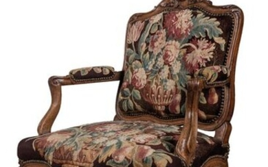 QUEEN REGENCE FABRIC in moulded and carved walnut, the back is decorated with a scrolled backrest cushioned by a flower with an asymmetrical stem surrounded on one side by leaves and on the other side by a flower. The shoulder with acanthus leaf...