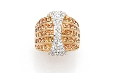 RING domed in yellow and white gold (750‰) centered...