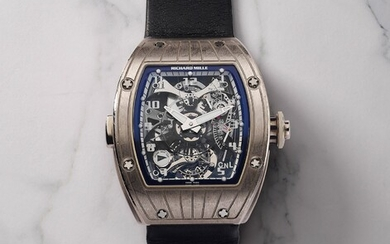 Richard Mille, Ref. RM015 A very attractive and fine white gold tourbillon wrist watch with dual time zone, torque, power reserve, warranty and presentation box