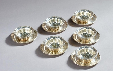 Set of 6 silver cups and their saucers with contoured edges.