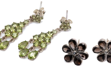 TWO PAIRS OF SILVER GEMSET EARRINGS; 31mm long chandelier drops set with round cut peridots to fringe of pear cut peridots, others 1...