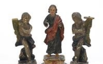 Three 18th century polychrome painted carved wood