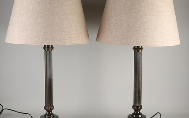 Two bronze-colored metal table lamps. Second half